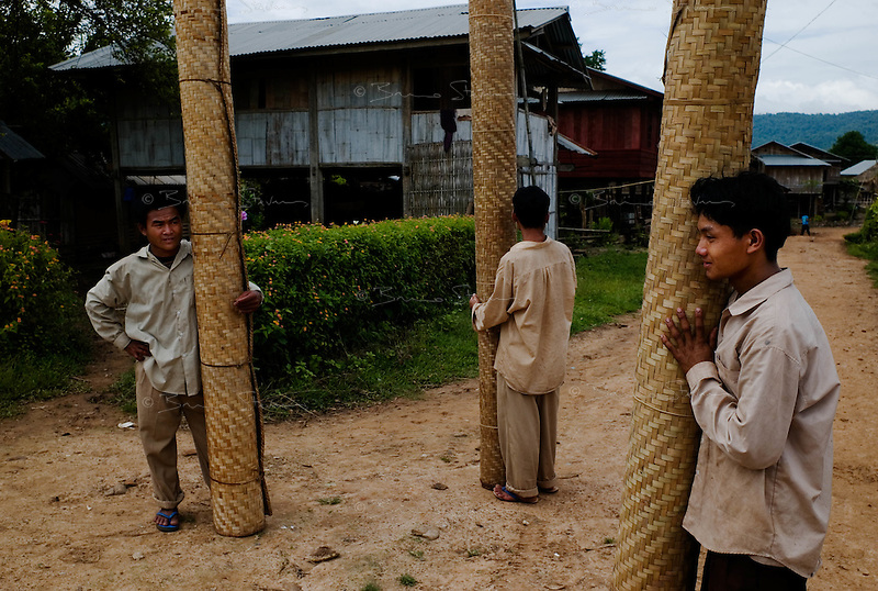 Ou Tai, north Laos, August 14, 2007.Bamboo mats salesmen. Ou Tai is the last district town before the Chinese border, 45km away. Many Chinese come to Laos for business, often very basic trade, such as bamboo shoots export to China.