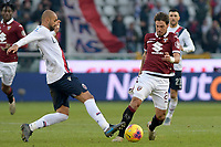 12th January 2020; Olympic Grande Torino Stadium, Turin, Piedmont, Italy; Serie A Football, Torino versus Bologna; Danilo of Bologna FC steals the ball from Simone Verdi of Torino FC - Editorial Use