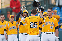 Shockers celebrate a score during the NCAA matchup between the Wichita State Shockers and North Dakota Fighting Sioux at Eck Stadium on February 26th, 2012 in Wichita, Kansas.  The Shockers defeated UND 16-1.  (William Purnell/Four Seam Images)