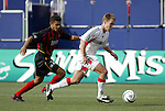 17 April 2004: Amado Guevara (left) chases after Bryan Namoff (right) in the first half. The MetroStars defeated DC United 3-2 at Giants Stadium in East Rutherford, NJ during a regular season Major League Soccer game..