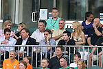 14 May 2010: Miami FC team president Aaron Davidson (center with phone) watches the game from the owners box in front of Carolina RailHawks owner Selby Wellman (behind, in beige t-shirt). The FC Tampa Bay Rowdies defeated the Carolina RailHawks 2-1 at WakeMed Stadium in Cary, North Carolina in a regular season U.S. Soccer Division-2 soccer game.
