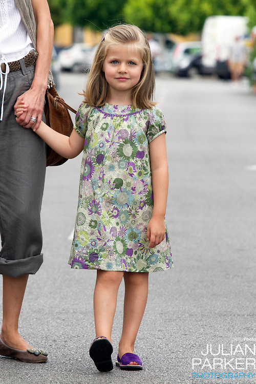 Crown Princess Letizia, and daughters Princess Leonor, and Princess Sofia, arrive at The Royal Yacht Club, in Palma, Mallorca, to meet.Crown Prince Felipe after he  competed  in the second day of the Copa Del Rey sailing regatta.. (Princess Leonor in picture )