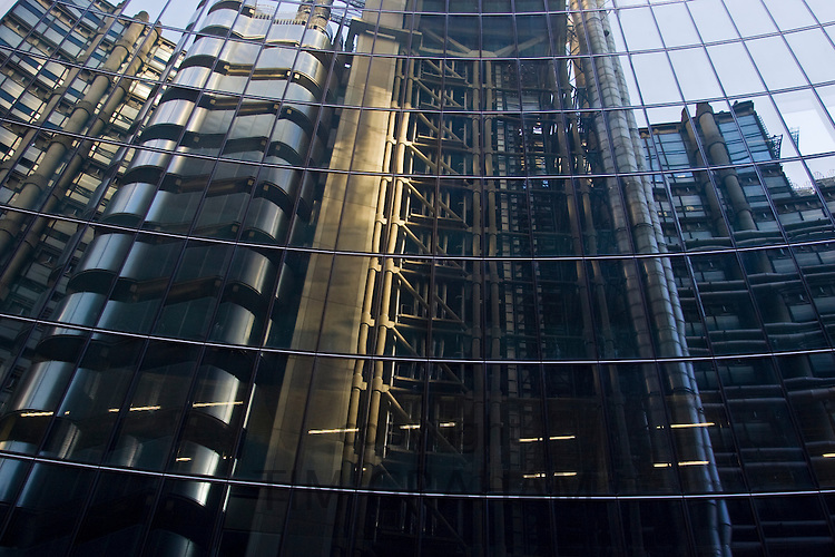 The Lloyd's Building reflected in the windows of The Willis Building, London, England, United Kingdom