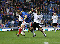 Danny Carmichael (right) tackles Lewis McLeod in the Rangers v Queen of the South Quarter Final match in the Ramsdens Cup played at Ibrox Stadium, Glasgow on 18.9.12.