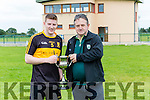 Dr Crokes Captain Mark Egan receives the McElligott cup from Stephen O'Sullivan after defeating Rathmore to complete their 5 in a row in Rathmore on Saturday