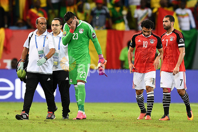 Egypt's goalkeeper Ahmed El-Shenawy reacts as he walks off the pitch due to an injury during the 2017 Africa Cup of Nations group D football match between Mali and Egypt in Port-Gentil on January 17, 2017. Photo by Stranger