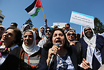 Palestinian women take part during a protest against violence towards women and demanding to end the Israeli occupation on International Women's Day, in Gaza city on March 08, 2017. Photo by Ashraf Amra