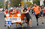 WATERBURY, CT - 08 OCTOBER 2017 -101417JW03.jpg -- The Worx Branding team tries to keep their bed straight as they race it down Grand Street during the first United Way Bed Race Fundraiser in over 20 years, Saturday afternoon. Jonathan Wilcox Republican-American