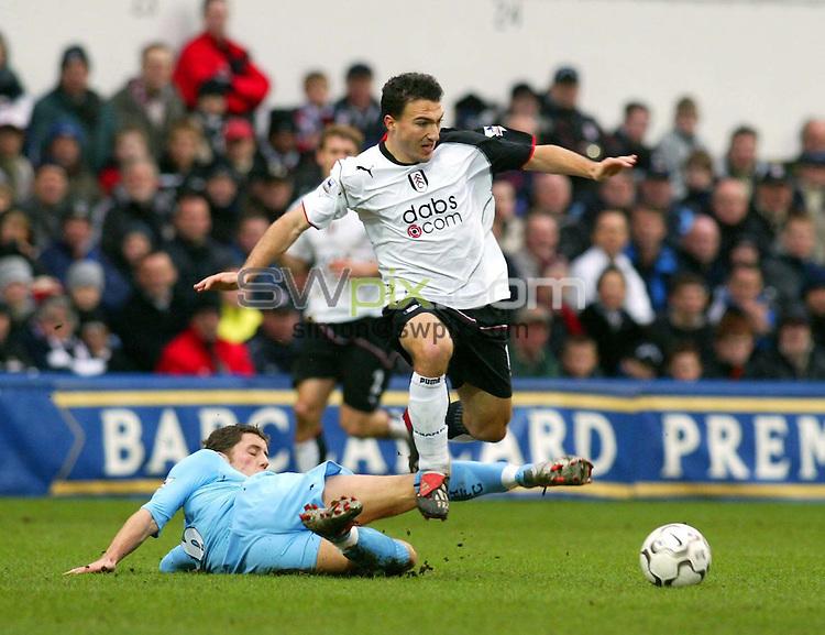 Pix: Rob Matthews/SWpix.com. Soccer. Barclaycard Premiership. Season 2003/2004. Fulham v Tottenham 31/1/2004...COPYWRIGHT PICTURE>>SIMON WILKINSON>>01943 608782>>..Steed Malbranque avoids the tackle of Michael Brown...