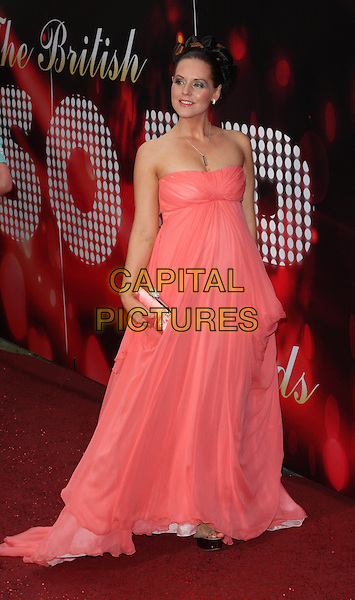 STEPHANIE WARING.British Soap Awards 2010 at the London ITV Studios, South Bank, London, England..May 8th 2010.arrivals full length pink sheer dress gown strapless clutch bag pregnant maternity .CAP/ROS.©Steve Ross/Capital Pictures.
