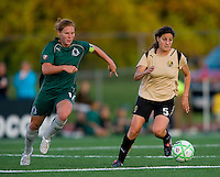 FC Gold Pride midfielder Tina DiMartino (5) handles the ball as St. Louis Athletica midfielder Lori Chalupny (17) pursues during a WPS match at Korte Stadium, in St. Louis, MO, May 9 2009. St. Louis Athletica won the match 1-0.