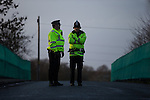 © Joel Goodman - 07973 332324 . 26/01/2014 . Salford , UK . Police kept a very low profile . Protesters march to an iGas fracking exploration site at Barton Moss , Salford , today (Sunday 26th January 2014) . A long term protest camp has been established on an access road leading to the site and today (26th January) protesters from other areas of the country travelled to the site to join with other protesters against fracking . Photo credit : Joel Goodman