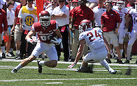 NWA Democrat-Gazette/Michael Woods --04/25/2015--w@NWAMICHAELW... University of Arkansas receiver Drew Morgan slips past Ryder Lucas for a big gain during the 2015 Red-White game Saturday afternoon at Razorback Stadium in Fayetteville.