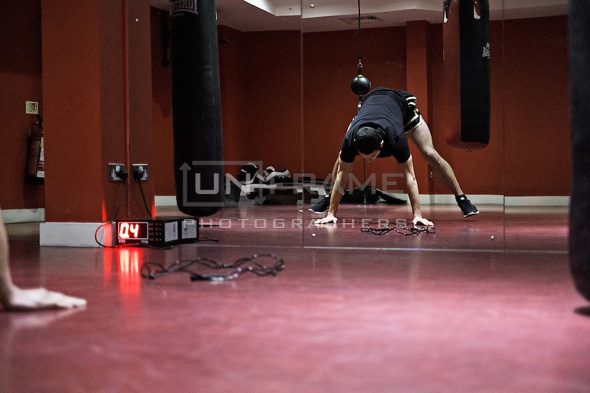 Przemek Kierpacz, a professional Muay Thai boxer and also an advocate for Roma Support Group, warms up for training in his local gym. London, UK, 9th March 2015.