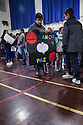 "Melrose Leadership Academy students lead a peace march through Oakland's Maxwell Park Neighborhood on Wednesday, December 7th. The event included an assembly with a video, ""Dear Mr. Trump"", created by the MLA 8th graders."