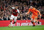 Arsenal's Theo Walcott tussles with Liverpool's Andrew Robertson during the premier league match at the Emirates Stadium, London. Picture date 22nd December 2017. Picture credit should read: David Klein/Sportimage