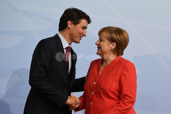 German chancellor Angela Merkel greets the Canadian prime minister Justin Trudeau at the G20 summit in Hamburg, Germany, 7 July 2017. The heads of the governments of the G20 group of countries are meeting in Hamburg on the 7-8 July 2017. Photo: Bernd Von Jutrczenka/dpa-pool/dpa /MediaPunch ***FOR USA ONLY***