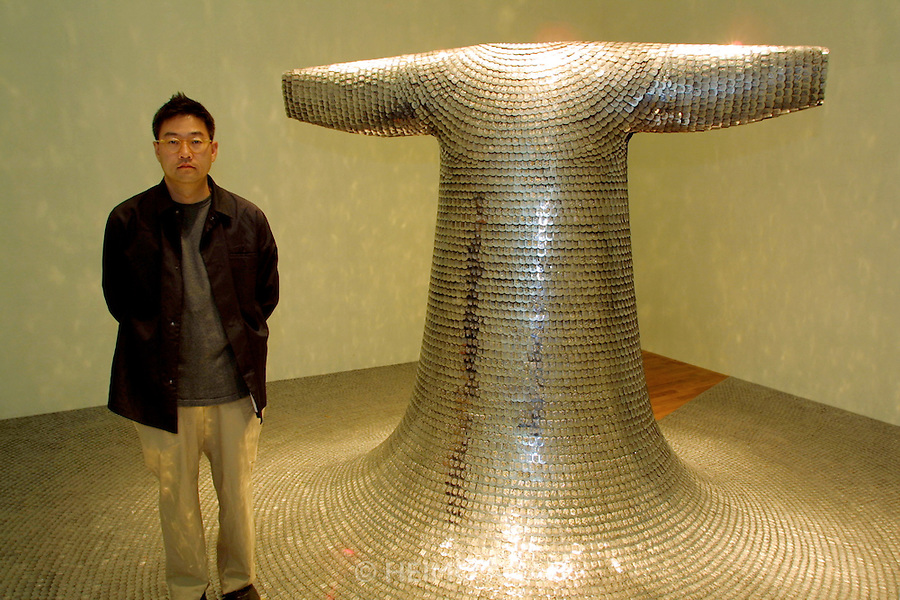 "VENICE, ITALY..49th Biennale of Venice.Korean Pavillion..Do-Ho Suh with his sculpture ""Some/One"", 2001..(Photo by Heimo Aga)"