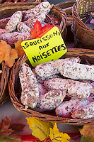 Traditional French sausages made with hazelnuts, saucissons aux noisettes, on sale at food market in Normandy, France