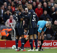 Manchester City's Raheem Sterling (left) and Gabriel Jesus confer as Referee Martin Atkinson prepares for a Liverpool free-kick <br /> <br /> Photographer Rich Linley/CameraSport<br /> <br /> The Premier League - Liverpool v Manchester City - Sunday 7th October 2018 - Anfield - Liverpool<br /> <br /> World Copyright &copy; 2018 CameraSport. All rights reserved. 43 Linden Ave. Countesthorpe. Leicester. England. LE8 5PG - Tel: +44 (0) 116 277 4147 - admin@camerasport.com - www.camerasport.com