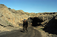 Coal mining worker walks out from the underground coal mine field in Wu Hai Xi, Inner Mongolia, China..