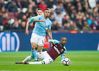 Manchester City Gabriel Jesus  and West Ham's Patrice Evra during the EPL - Premier League match between West Ham United and Manchester City at the Olympic Park, London, England on 29 April 2018. Photo by Andrew Aleksiejczuk / PRiME Media Images.
