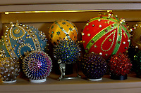 A variety of balls and spheres are on display Friday, May 15, 2020, in the living room that also doubles as the Ozark Ball Museum of Kelly and Donna Muhollan, who are the folk music duo Still on the Hill, in Fayetteville. Check out nwaonline.com/200524Daily/ and nwadg.com/photos for a photo gallery.<br /> (NWA Democrat-Gazette/David Gottschalk)