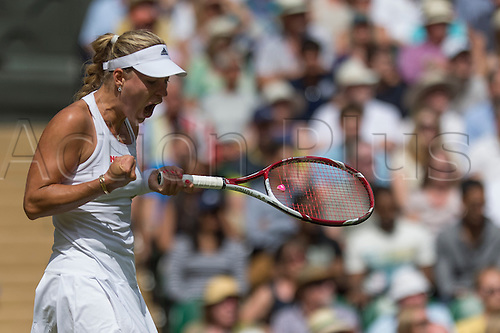 01.07.2014.  London, England.  Wimbledon Championships Day Eight  Angelique Kerber of Germany celebrates after winning a point  against Maria Sharapova of Russia during day eight ladies singles fourth round match at the Wimbledon Tennis Championships at The All England Lawn Tennis Club in London, United Kingdom