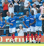 Portsmouth celebrate their second goal with scorer Frederic Piqionne 2nd left