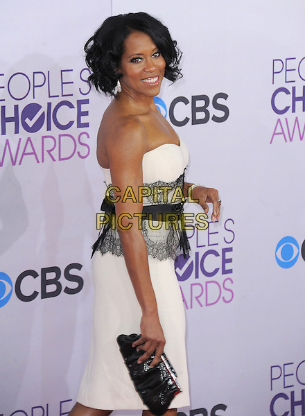 Regina King.The 2013 People's Choice Awards held at Nokia Live in Los Angeles, California 9th January 2013                                                                   .half length white strapless dress lace clutch bag belt black side .CAP/DVS.©DVS/Capital Pictures.