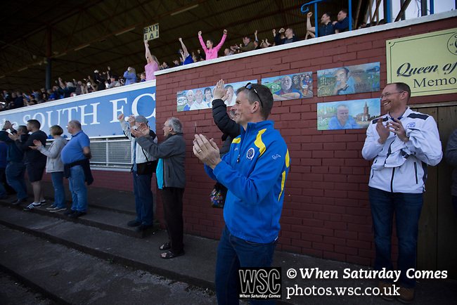 Home fans in the main stand and enclosure cheering their team's second goal scored by Joe Thompson at Palmerston Park, Dumfries as Queen of the South hosted Dundee United in a Scottish Championship fixture. The home has played at the same ground since its formation in 1919. Queens won the match 3-0 watched by a crowd of 1,531 spectators.