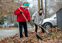 NWA Media/JASON IVESTER --12/13/2014--<br /> Jacyln (cq) Neff (left) and Erica Reaser, both Rogers Heritage freshmen, rake leaves at a residence near the school on Saturday, Dec. 13, 2014, as part of the school's Community Leaf Removal Day.