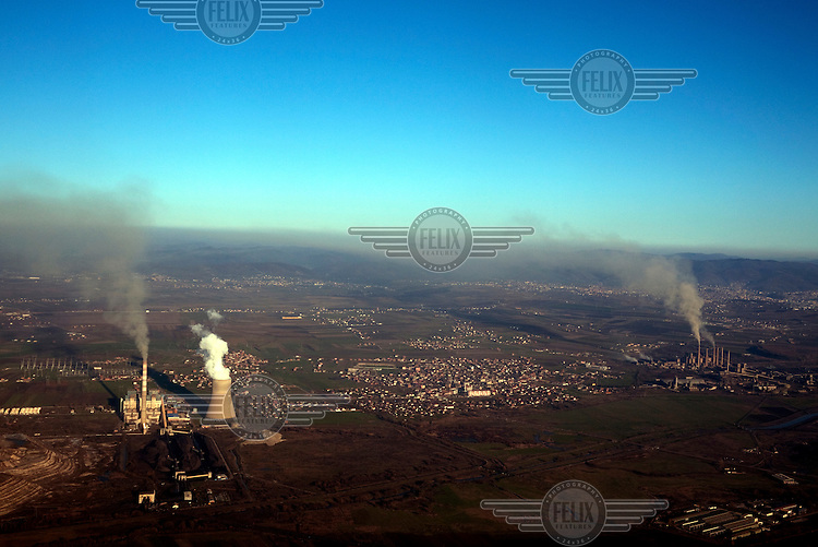 The Kosovo B (left) and the Kosovo A power plants. Kosovo A is a lignite power station, the oldest in the country, opened in 1962. The European Union has demanded that the plant must close by 2017. It has no filtration system and is estimated to pump 2.5 tons of lignite dust into the atmosphere every hour, this exceeds the EU limit by 74 times and is said by the Kosovo Ministry of Environment to be responsible for 63 percent of baby fatalities and 48 percent of stillborn babies in Obiliq/Kastriot (Serbian/Albanian) the town nearest to the plant.