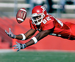 Rutgers # 82--wide receiver Aaron Martin dives but can't reach at Ryan Cubit pass thrown during the 1st half of play at Rutgers Stadium, Piscataway on Fri Nov 23,2001.<br />