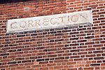Correction sign in brick wall of former youth prison