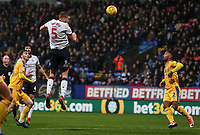 Bolton Wanderers' Mark Beevers heads at goal <br /> <br /> Photographer Andrew Kearns/CameraSport<br /> <br /> The EFL Sky Bet Championship - Bolton Wanderers v Wigan Athletic - Saturday 1st December 2018 - University of Bolton Stadium - Bolton<br /> <br /> World Copyright © 2018 CameraSport. All rights reserved. 43 Linden Ave. Countesthorpe. Leicester. England. LE8 5PG - Tel: +44 (0) 116 277 4147 - admin@camerasport.com - www.camerasport.com
