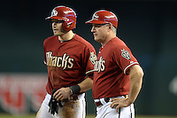 Arizona Diamondbacks coach Steve Sax (5) talks with A.J. Pollock during a game against the Washington Nationals at Chase Field on September 29, 2013 in Phoenix, Arizona.  Arizona defeated Washington 3-2.  (Mike Janes/Four Seam Images)