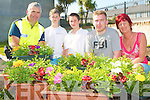 FLOWER POWER: Just some of the local children who planted and gave out up to 83 window boxes to the homes of Rahooane and Cois Coille estates as part of the Just Us Project at Rahooane community centre on Thursday l-r: Community Garda Seamus Moriarty, Francie McCarthy, Cois Coille, Damien Murphy, Rathooane and Brian O'Shea and Alice O'Connor from the Just Us Project.