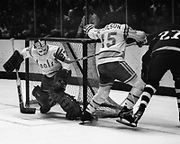 """Seals goalie Gilles Meloche and Jim Neilson battle Toronto Maple Leafs Dave """"Tiger"""" Williams..<br />(1975 photo/Ron Riesterer)"""