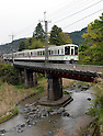 April 23, 2013, Hanno, Japan - A Seibu Railway Co.'s train bound for Chichibu, some 112 km northwest of Tokyo, crosses a bridge near Musashi-Yokote Station of the company's 19-km Seibu Chichibu Line on Tuesday, April 23, 2013...U.S. equity fund Cerberus Capital Management has made an tender offer to boost its stake from the present 32 percent to nearly 45 percent in an apparent bid to take the initiative in managing Seibu Holdings,  the railway and hotel operator. Rumors that the U.S. investment firm is demanding that the unprofitable local line be closed made local governor and community leaders run to Seibu Holdings to make their case to keep the line open. The six-station line, which opened in 1969, is used by about 10,000 people daily.  (Photo by Natsuki Sakai/AFLO)