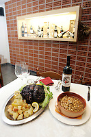 Stracotto con patate, a sinistra, e pasta e ceci, nella Trattoria del Mercato ad Asti.<br /> Stracotto with potatoes, bottom left, and pasta with chickpeas, in the Trattoria del Mercato restaurant in Asti.<br /> UPDATE IMAGES PRESS/Riccardo De Luca
