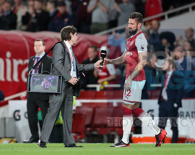Arsenal's Olivier Giroud gets interviewed on the pitch at the final whistle during the premier league match at the Emirates Stadium, London. Picture date 11th August 2017. Picture credit should read: David Klein/Sportimage