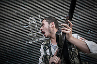 A rebel fighter belonging to the Kateba Omar Ben Abdul Aziz carries out a militar operation as he and his group try to gain terrain over the Syrian army building by building at Aamria front line in Aleppo City..