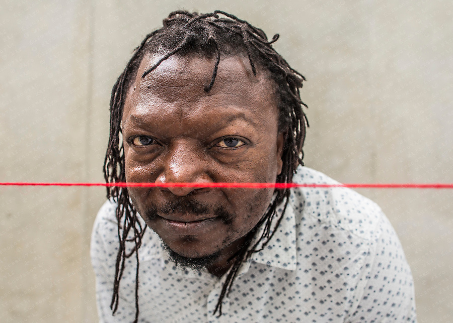 """Cameroonian artist Pascale Marthine Tayou poses for a portrait at this  """" I love you! """" exhibition the Kunsthaus Bregenz in Bregenz."""