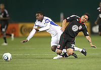Jaime Moreno #99 of D.C.United falls after a tackle by Pablo Escobar #6 of the Kansas City Wizards during an MLS match at RFK Stadium on May 5 2010, in Washington DC. United won 2-1