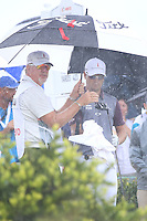 151206  Damon Green and Zach Johnson are already soaked on the 1st tee during Sunday's Final Round of the Hero World Challenge at The Albany Golf Club, in New Providence, Nassau, Bahamas.(photo credit : kenneth e. dennis/kendennisphoto.com)