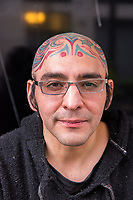 Mexico, Mexico City. Day of the Dead, Dia de los Muertos. Man with head tattoo.