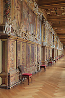 The Galerie Francois I, begun 1528, the first great gallery in France and the origination of the Renaissance style in France, Chateau de Fontainebleau, France. The gallery is lined with frescoes by Rosso Fiorentino, made 1522-40 and framed in carved stucco. The Palace of Fontainebleau is one of the largest French royal palaces and was begun in the early 16th century for Francois I. It was listed as a UNESCO World Heritage Site in 1981. Picture by Manuel Cohen