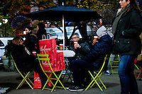 People with packages for Christmas holidays rest on a bench in New York, 12/9/2015 Photo by VIEWpress