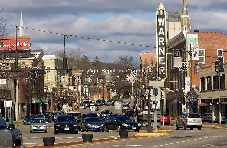 TORRINGTON, CT. 24 November 2012-112412SV01-Cars pass through downtown past the Warner Theatre in Torrington Saturday. The city wants to hire consultants who will oversee and coordinate the downtown. .Steven Valenti Republican-American